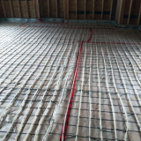"""In floor heating pipes before concrete is poured"""