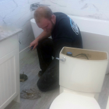 James installing new toilet